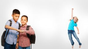 Two Young Boys Wearing Backpacks, Fist Bumping and Young Girl Jumping
